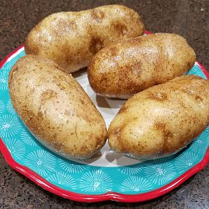 Potatos covered in oil and salt