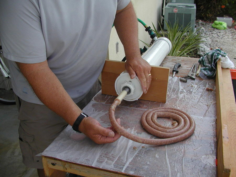 Homemade water powered sausage stuffer smoking meat forums others have used thick plastic cutting boards and thick sheet plastic but i went another direction using a 3 pvc glue cap sciox Images